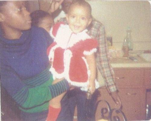Caption: Christmas with my first foster mother, 1 year old.